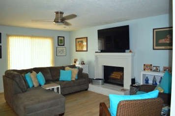 Enjoy the fireplace or watch the game on the big screen TV!